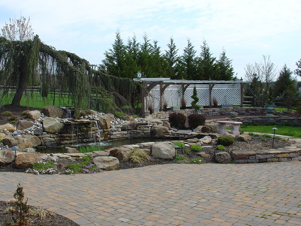 Fully landscaped pond, patio and arbor